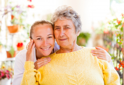 a photo of a happy senior woman with her caregiver