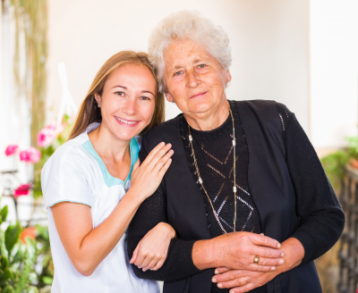 photo of happy elderly woman with her caregiver
